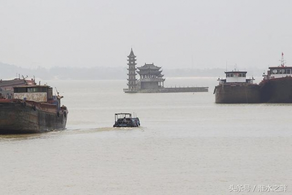中國這座古建築物,一年隻出現一次,其餘時間全部沉入湖水中